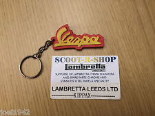 VESPA KEY RING - RED AND YELLOW -  RUBBER - VESPA LOGO. NEW