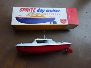 SPRITE DAY CRUISER - CLOCKWORK RED BASE - SUTCLIFFE TOY