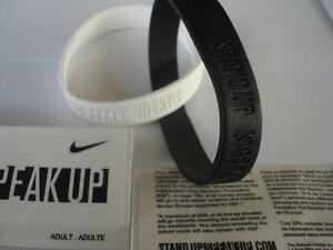 Say NO to TERRORISM with black and white NIKE STAND UP SPEAK UP bracelets