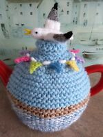 Hand-knitted holidays in Cornwall seaside tea cosy with seagull and bunting
