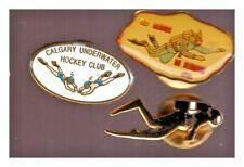 Scuba diving pins: Calgary Underwater hoockey Club; Huards de Fermont; diver