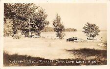 Carp Lake Michigan~Pleasant Beach Tourist Camp~Boat Dock & Cottage~c1930s RPPC