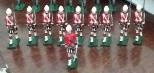 Britain's Gordon Highlanders 10 men in full ceremonial uniform