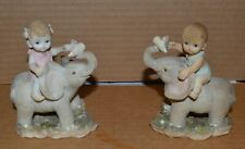 Vintage Small Gray Elephant with Baby Riding and Elephant holding Bottle (Pair)