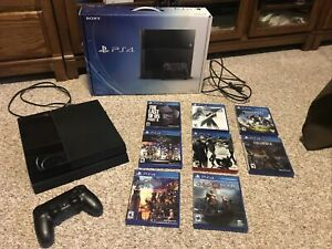 Sony PlayStation 4 500GB Black Console + Controller + 8 Greatest Games