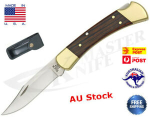 Genuine Buck 110 Folding Hunting Blade, Dymondwood Handle Leather Sheath USA