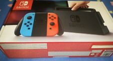 Nintendo Switch Avec Sa Boîte Et Ses Accessoires.