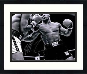 """Framed Mike Tyson Autographed 16"""" x 20"""" Black & White Punching Photograph"""