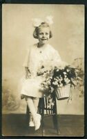 RPPC HAPPY LIL GIRL w HAIR BOW & BASKET ANTIQUE REAL PHOTO POSTCARD circa 1905
