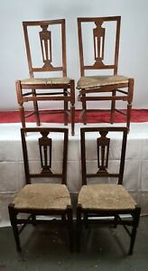 SET OF 4 CHAIRS. CARVED WOOD AND WICKER. CHARLES IV STYLE. CENTURY XVIII.