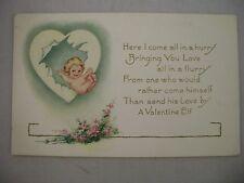 VINTAGE EMBOSSED VALENTINE'S POSTCARD CUPID FLYING THROUGH A HEART W/ FLOWERS