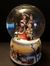 Christmas Carolers winter musical snow globe new in box