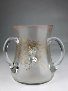 Mount Joye, French unsigned three handle sharing mug decorated with flowers.