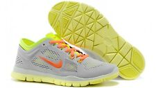 NIKE WOMEN'S FREE 5.0 TR FIT 4 SHOES SIZE 11.5 grey orange volt 629496 003