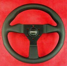 Genuine Momo Monte Carlo black stitch, black leather 320mm steering wheel.