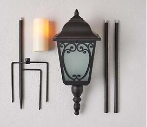 Adjustable Indoor/Outdoor Flickering Flame Candle Lantern $47 TINI {&}