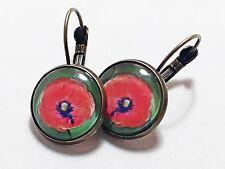 Pendientes artesanales redondos con una flor roja de Tricia Kaez, 10mm