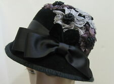 Claudia DeSouza black  felt cloche hat with flower leaf and bow detail