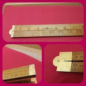 Vintage Hardwood And Brass Hinged 1 metre Folding Rule.
