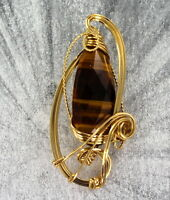 TIGER EYE GEMSTONE PENDANT IN 14KT ROLLED GOLD  SETTING  WIRE WRAPPED