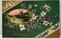 Hearty Greetings Windmill Scene Gilded Embossed Flowers Postcard E20