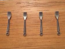 Miniature flatware/silverware. Lot of four metal forks.