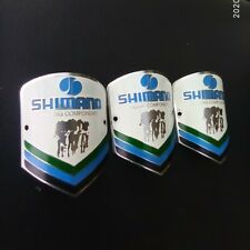 NOS 3X VINTAGE shimano BICYCLE HEAD BADGE BIKE emblem badge logo 1970 racing
