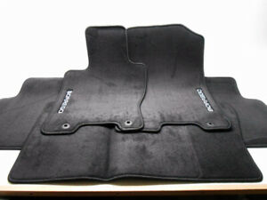 New OEM Kia Borrego Floor Mat Set Round Grommet Holes 2009-2011