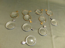 "10 glass optomerist test lens gold silver discs 1 1/2"" across strength on tab"