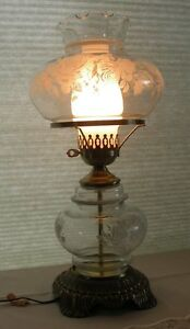 Antique style metal base table lamp with glass chimney and floral glass shade