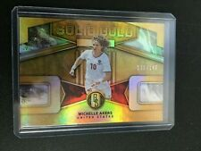 F70123  2019-20 Panini FIFA Gold Standard Solid Gold #17 Michelle Akers /149