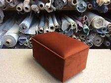 footstool / pouffe upholstered in burnt orange velvet