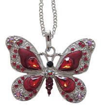 Collier, pendentif motif papillon rouge dominant cristal autrichien et acier.