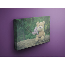Teddy Bear Sits on a Log Holding Purple Flowers 16x24 Canvas Wrap Wood Frame