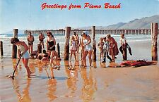 Pismo Beach California bathers clam digging on beach vintage pc (Y8627)