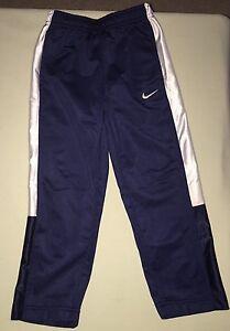 USED NIKE TRACK SUIT PANTS SIZE 4 NAVY BLUE WHITE