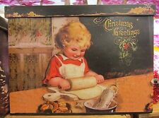 """Christmas Tin w/ Cover Decorative Greetings & Child 12"""" wide x 9.5 """" tall"""