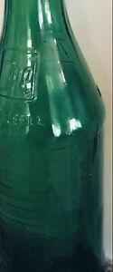 VINTAGE 7 UP BOTTLE WITH 7UP EMBOSSED ON BOTH SIDES OF BOTTLE NECK and body