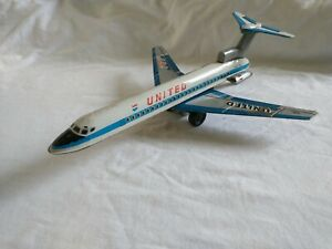 Vintage Tin Friction Toy Aeroplane - United Airlines,  McDonnell Douglas DC-10