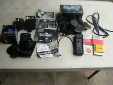 Canon AE-1 Camera w/ Zoom lense, Flash, Lens, Strap, Winder, Filter, Manuals