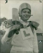 Yale Newman wearing uniform and holding a cricket bat. - Vintage photo