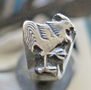 Bookbinding: rare brass stamp for Golden Cockerel Press bindings