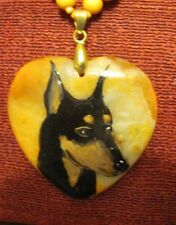 Standard Manchester Terrier hand painted on orange Onxy Agate pendant/bead/neckl