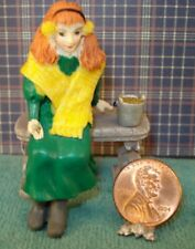 About 1/24'' scale resin sitting girl with pale 2 1/4'' tall