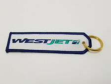 WESTJET AIRLINES - ( NEW )  KEY CHAIN / TAG.