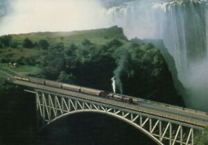 Old postcard : Beyer-Garrett engine with coaches crossing Victoria Falls Bridge