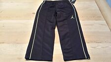 New Puma boy size 4 solid black & lime green striped athletic pants was $43