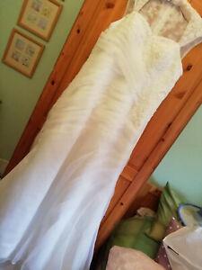Beautiful wedding dress, size 12, beaded embellishments. Never worn.