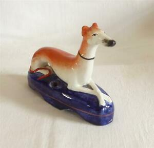 GOOD SIZED ANTIQUE MID 19THC STAFFORDSHIRE FIGURE OF A GREYHOUND AS A PEN HOLDER