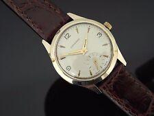 Gents VINTAGE GARRARD 9ct Solid Gold Mechanical orologio sul cinturino. intorno al 1966.